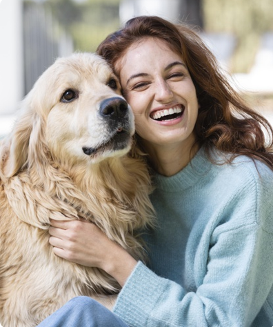 Footer image showing a smiling woman hugging her doggie
